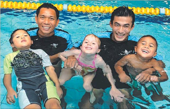 Ha Duc Minh Thao and VoVan Vinh with Max, 5, Mia, 4, and Caylan, 4. Photo, Leader Newspaper.