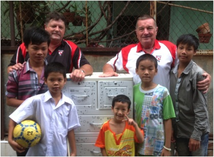 Glenn Noland and Ron Vernon at the Vung Tau Orphanage yesterday with the children.