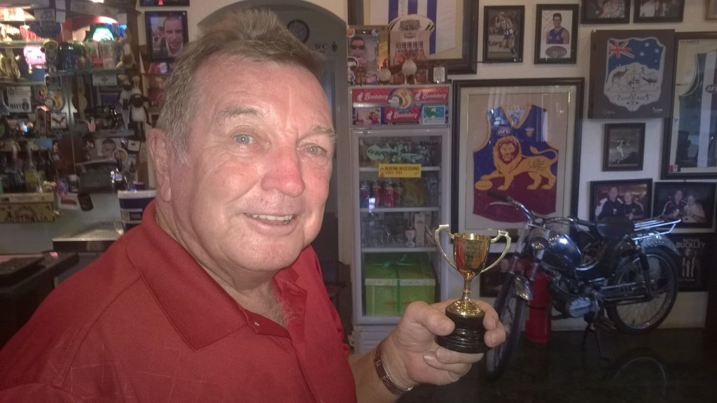 Ron Vernon with his 1967 Premiership Cup at Tommy's Bar, Vung Tau.